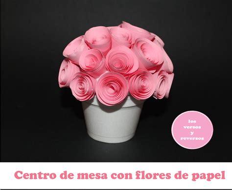 centro de mesa con flores de papel los versos y reversos