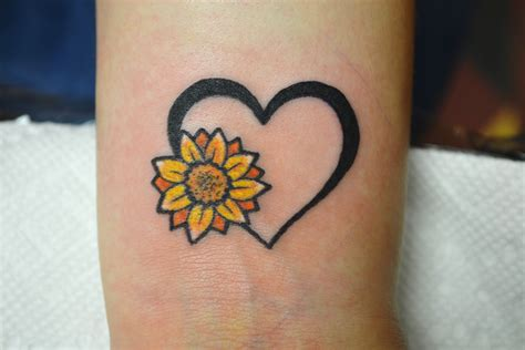 tiny heart tattoo designs tiny sunflower wrist artist adrienne