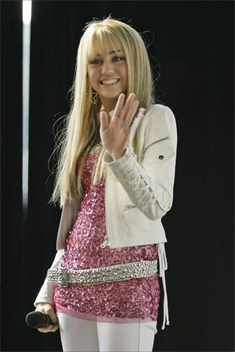 preteen luiza model sparkely pink shirt with a silver sprakely belt wight pants