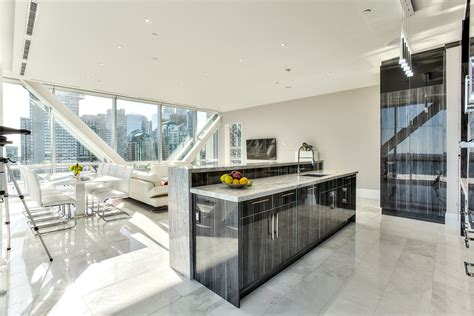 Kitchen View by Sleek Lakeview Penthouse At 39 Quay East Better