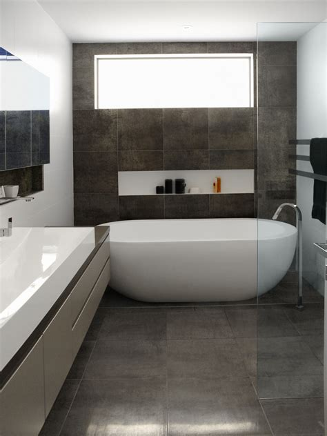 Badezimmer Fliesen Grau by Oval Freestanding Soaker Bathtubs On Grey Tile Floors