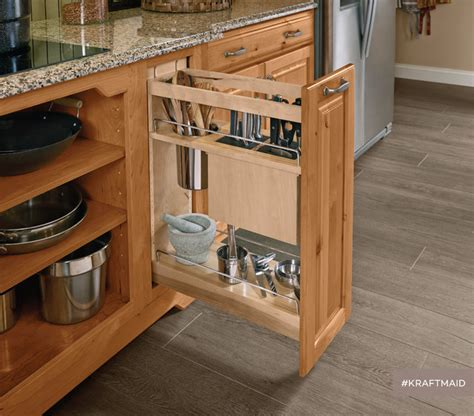 pull out storage for kitchen cabinets kraftmaid kitchen base pantry pull out utensil storage