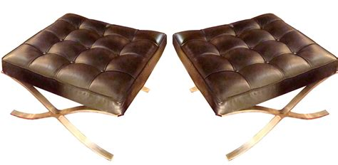 pair french mid century modern black leather ottomans