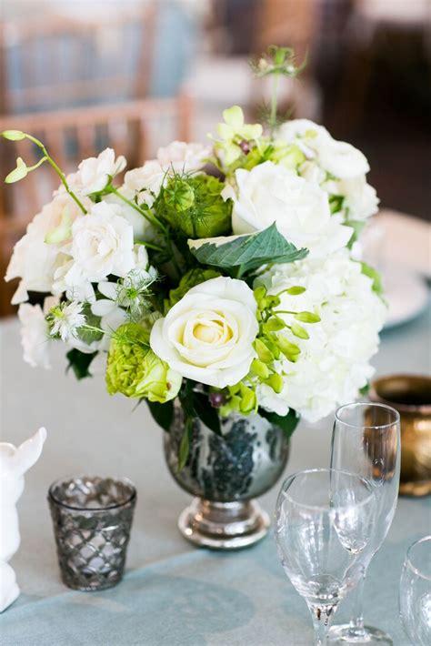 classic white rose centerpiece  mercury glass vase