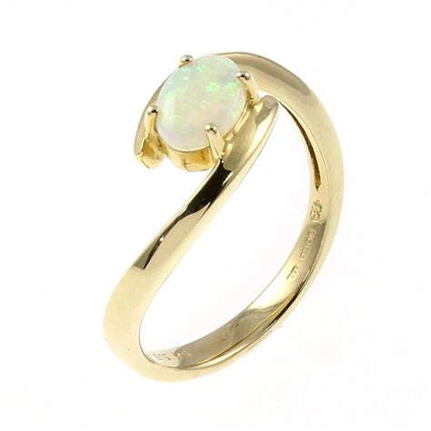 14ct yellow gold 0 46ct oval opal twist ring gemstone