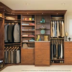 high end upscale walk in closet with built in wooden