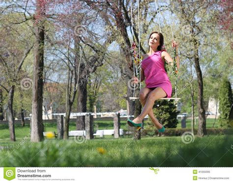 lady on swing sexy pink purple dress lady on a swing stock photo image