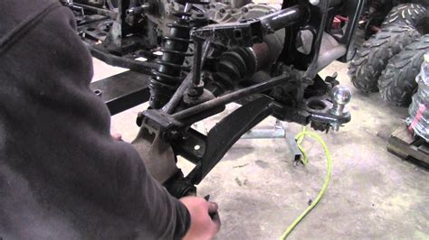 how to remove rear cv axle from polaris sportsman atv