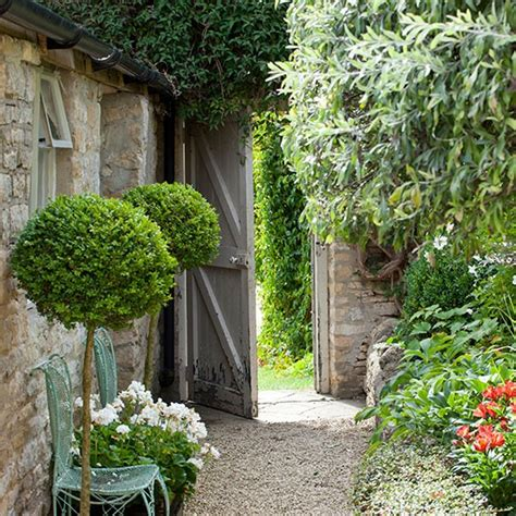 country garden with lollipop hedges and a gravel path country garden design ideas design