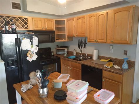 should i paint the inside of my kitchen cabinets painting my ugly kitchen cabinets from blonde wood color