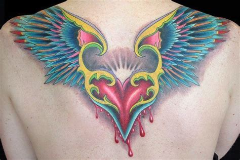 colored wings tattoo a color of a flying bleeding the wings look