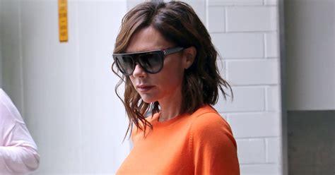 New Victotia Beckham Sesilia beckham has all on in bright orange