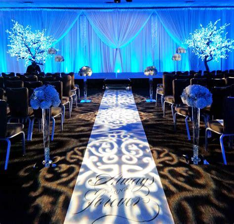 Christmas Floral Centerpiece Ideas - white winter wedding aisle dahlia floral design