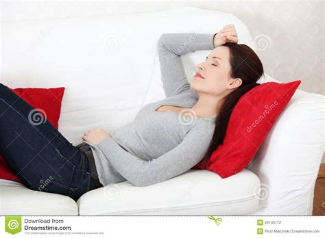 lying on the sofa beautiful woman lying on a sofa stock photography image