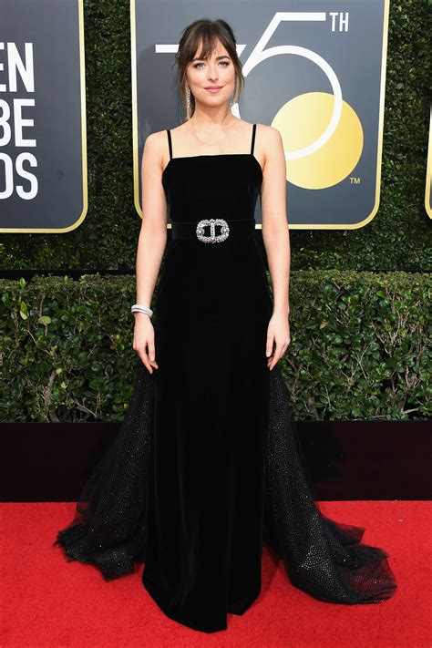The Globe Dress dakota johnson s black golden globes dress has a starburst