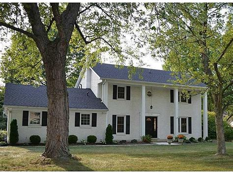 white colonial house white colonial style house with columns homeward bound