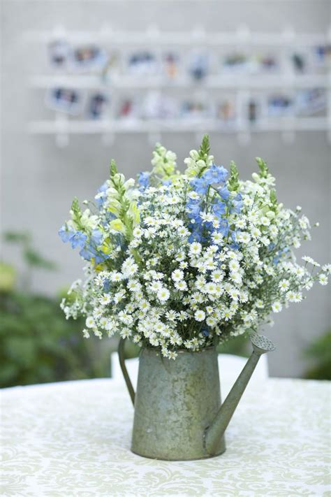 watering can centerpieces 25 best ideas about watering can centerpieces on rustic centerpieces wedding vase