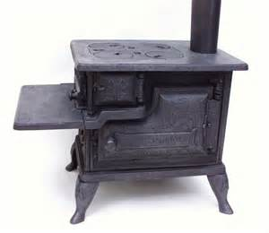 Toy or salesman sample size small stoves and other related antiques