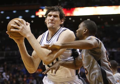 here are a bunch of photos of spurs boban marjanovic s