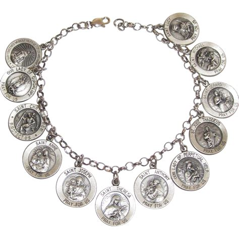 vintage sterling all saints charm bracelet from phalan on