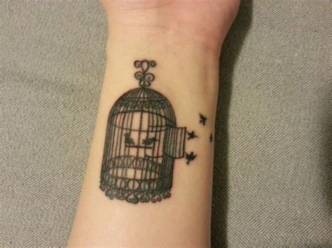 bird cage wrist tattoo 27 dazzling bird cage wrist tattoos