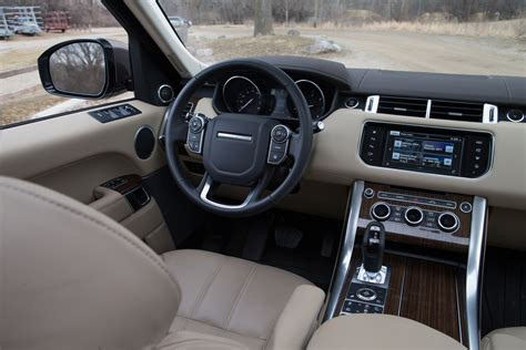 land rover hse interior electric or diesel bmw x5 xdrive40e vs range rover sport
