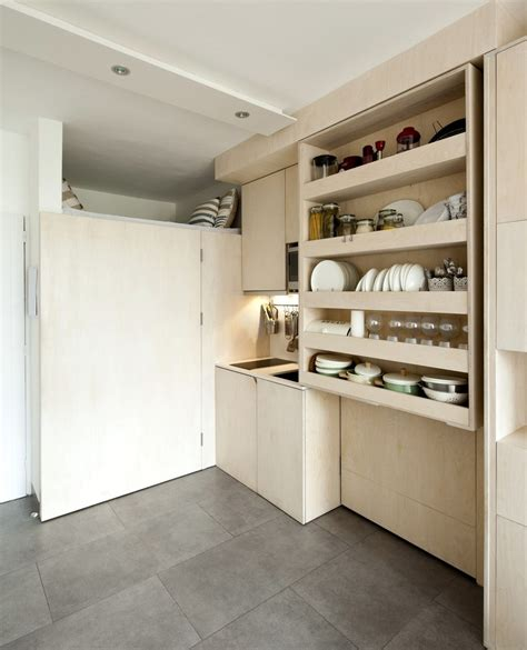 215 Square Feet In Meters transforming box makes it possible for family of three to