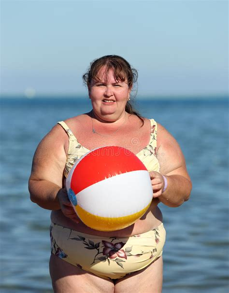how to photograph heavy women overweight woman with ball on beach stock photo image