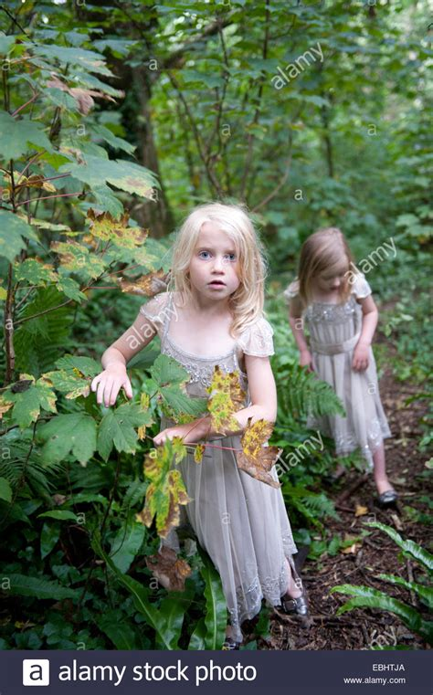 0008288607 the girl in the woods 2 girls lost in the woods stock photo royalty free image