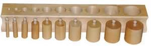 set of 4 montessori wooden knobbed cylinder blocks