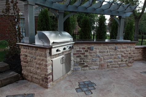 sted concrete outdoor kitchen with paver inlays