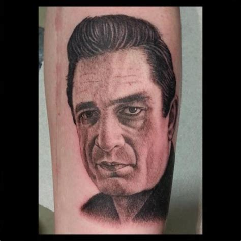 portrait realistic johnny cash tattoo by spilled ink tattoo