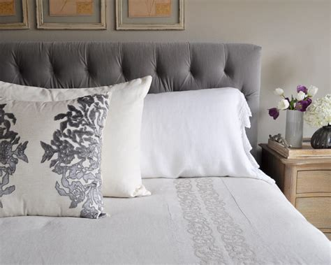 white tufted comforter bedroom bed with tufted headboard linen bedding gray and