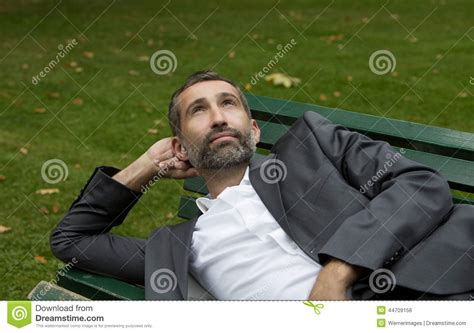 bench manly man lying on bench stock photo image 44709156