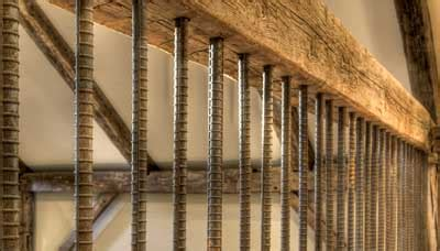 vertical rebar baluster rustic wood beam railing deck