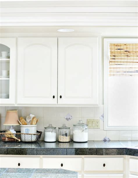 peel and stick tile backsplash accents at the picket fence