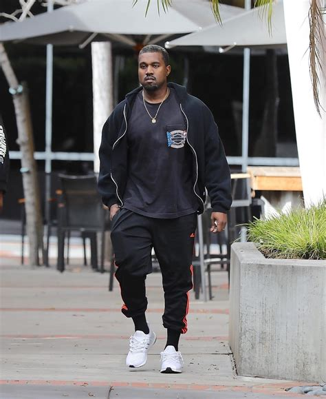 kanye west wears a prince t shirt and adidas sneakers going to the upscalehype