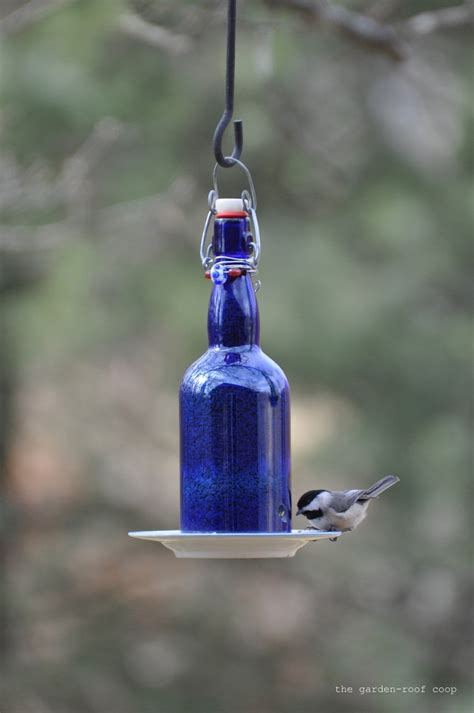 Feeders From A Wine Bottle how to make wine bottle bird feeder diy crafts handimania