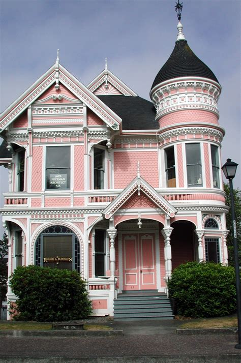 victorian queen anne home with gingerbread