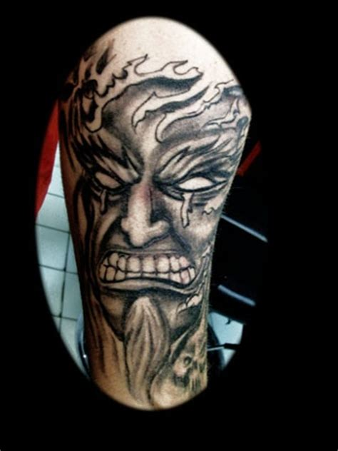 clockworktattoo evil face tattoo by tatupaul com
