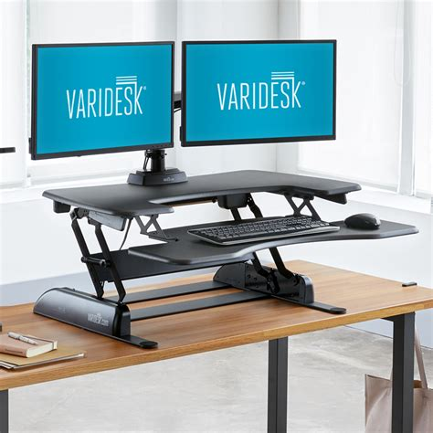 versa stand up desk height adjustable standing desks varidesk sit to stand desks