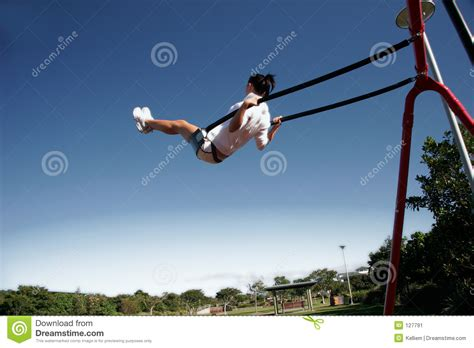 what s swinging swinging high stock image image of park girl playground
