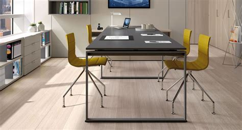 Office Solutions desks with frame leg office solution