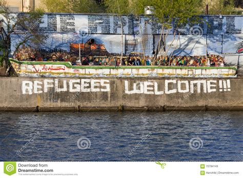 refugee boat price refugees welcome graffiti and refugee boat in berlin