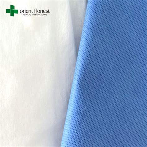 Pp Bedsheet Sprei Chequer Blue pp nonwoven bed sheet for hotel blood resistant sms surgeon bed sheet low cost bed cover