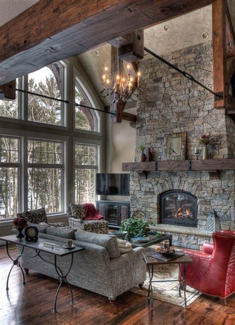 rustic great room  stone fireplace  wall  windows