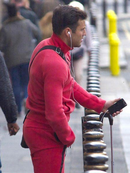 wright stands out in bright tracksuit as he