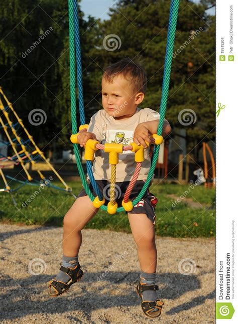 child rope swing little child in rope swing stock images image 19919204