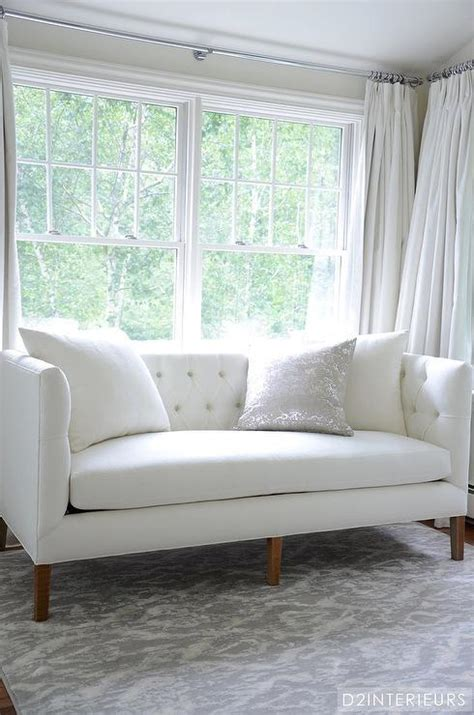 small white couch white and grey bedroom with white tufted sofa