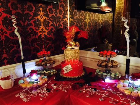 gold themes name sweet table at a masquerade themed red black gold party